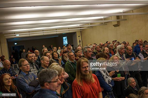 Fans follow the performance of the former East German rock band Speiches Monokel performs at the Hohenschoenhausen memorial and former prison of the...