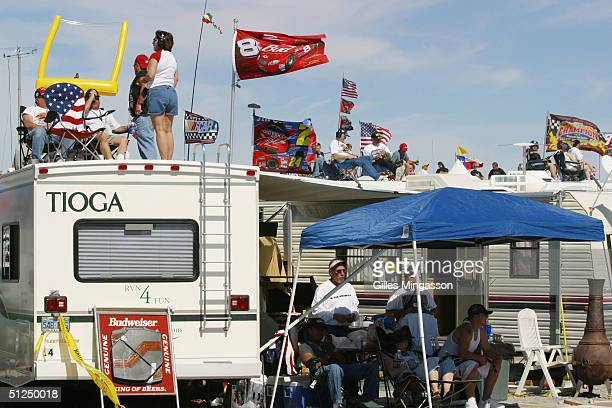 NASCAR fans follow the race from the top of their flag adorned motor homes parked in the race track's infield March 7 2004 in Las Vegas Nevada...