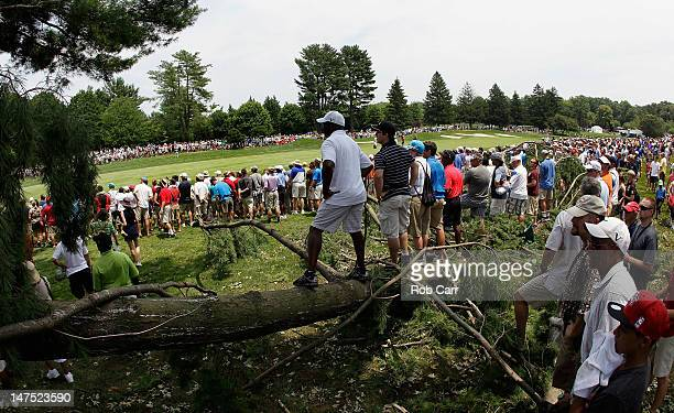 Fans follow the second shot of Tiger Woods along the number one fairway during the Final Round of the ATT National at Congressional Country Club on...