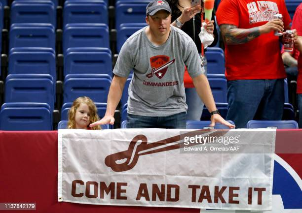 Fans for the San Antonio Commanders hold a banner before the Alliance of American Football game between the Salt Lake Stallions and the San Antonio...