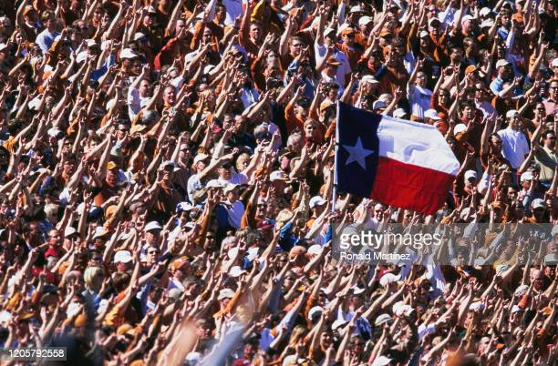 Fans for the University of Texas Longhorns raise the Texas State flag during the NCAA Southwest Conference college football game against the...
