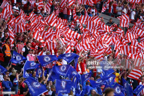 Fans from both teams wave their flags ahead of Kick off for the Emirates FA Cup Semi Final between Southampton FC and Chelsea FC at Wembley Stadium...