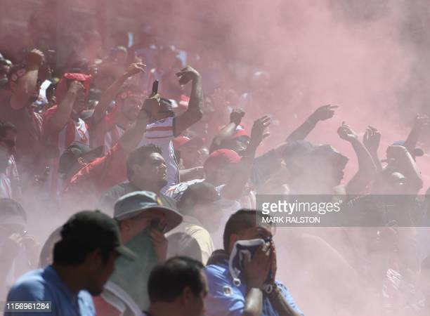 Fans from Chivas de Guadalajara fire flares during their 2019 International Champions Cup match against Benfica at the Levi's Stadium in Santa Clara...