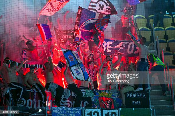 Fans from Kloten Flyers lighten some bengals in the end during the Champions Hockey League group stage game between HV71 Jonkoping and Kloten Flyers...