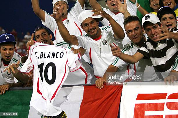 Fans from Mexico cheer on Blanco of the Chicago fire during a game between FC Dallas and the Chicago Fire September 20, 2007 at Pizza Hut Park in...
