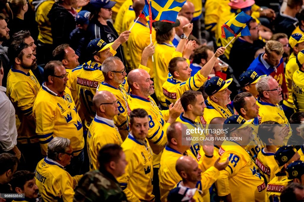 Fans from Sweden cheer during the IIHF World Championship group A ice hockey match between Russia and Sweden in Royal Arena in Copenhagen, on May 15, 2018. (Photo by Mads Claus Rasmussen / Ritzau Scanpix / AFP) / Denmark OUT