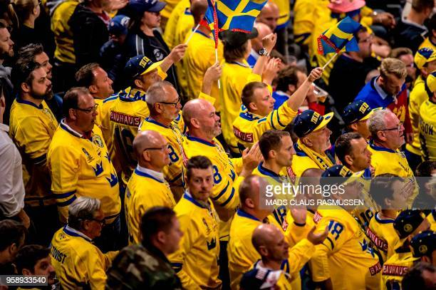 Fans from Sweden cheer during the IIHF World Championship group A ice hockey match between Russia and Sweden in Royal Arena in Copenhagen on May 15...