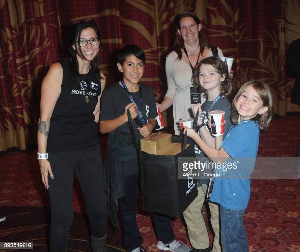 Fans from the Starlight Foundation and their prizes at the Opening Night Celebration Of Walt Disney Pictures And Lucasfilm's 'Star Wars The Last...