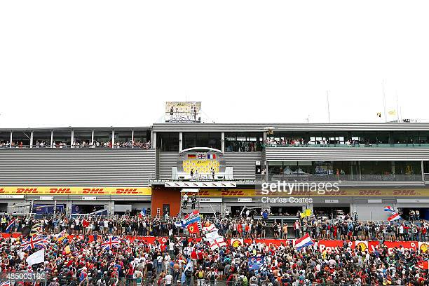Fans gather along the pit staright to watch the drivers on the podium after the Formula One Grand Prix of Belgium at Circuit de SpaFrancorchamps on...