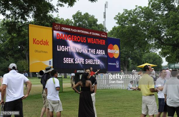 Fans gather around a leaderboard warning of of lightning in the area during the final round of the Crowne Plaza Invitational at Colonial Country Club...