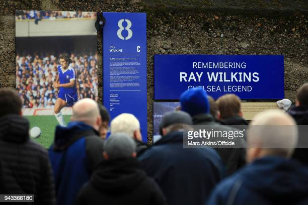 Fans gather around a tribute to the late Ray Wilkins during the Premier League match between Chelsea and West Ham United at Stamford Bridge on April...