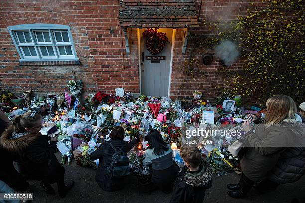 Fans gather around floral tributes left outside the Oxfordshire home of British pop singer George Michael on December 27 2016 in Goring England...