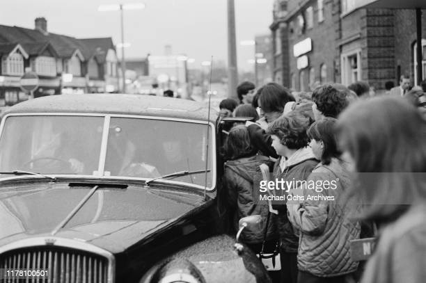 Fans gather around singer John Sebastian of American rock band the Lovin' Spoonful as he makes his way to the car during the group's visit to London...
