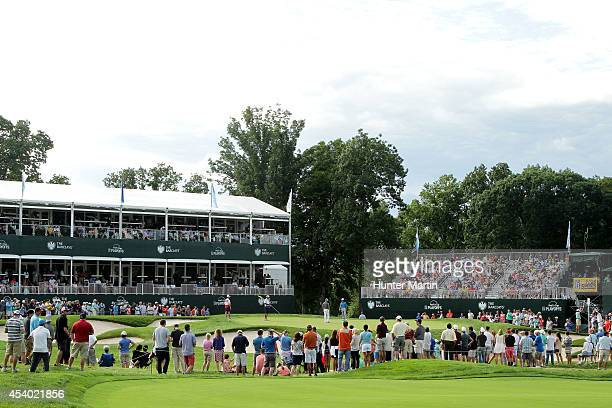 Fans gather around the 15th green during the third round of The Barclays at The Ridgewood Country Club on August 23 2014 in Paramus New Jersey