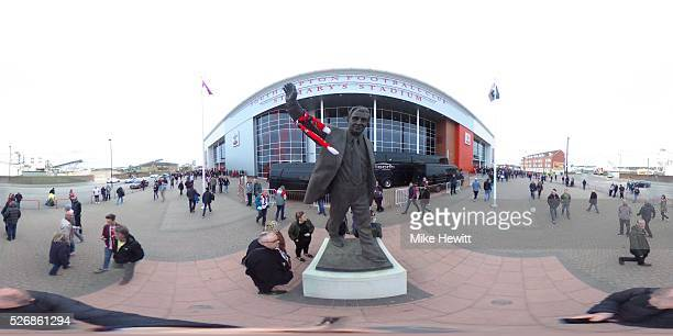 Fans gather around the Ted Bates statue outside the stadium prior to the Barclays Premier League match between Southampton and Manchester City at St...
