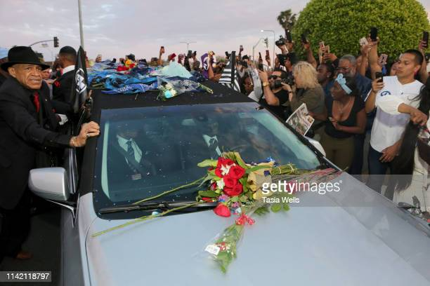 Fans gather as the hearse carrying Nipsey Hussle's body arrives at Angelus Funeral Home after Nipsey Hussle's Celebration of Life and Funeral...