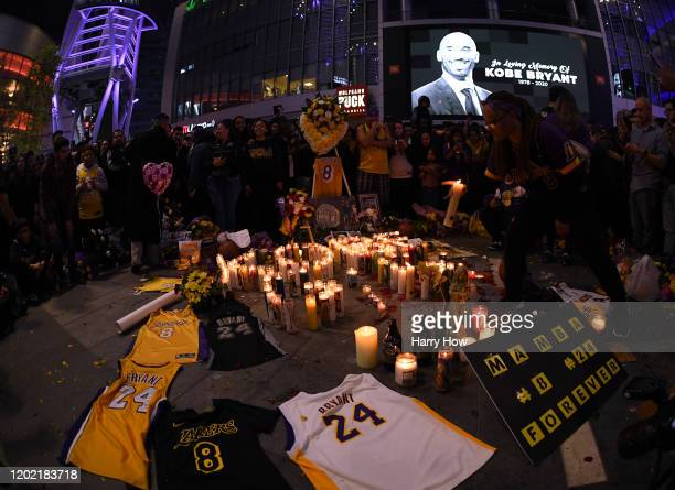 Fans gather at LA Live to pay tribute to Kobe Bryant who died earlier in a helicopter crash on January 26 2020 in Los Angeles California