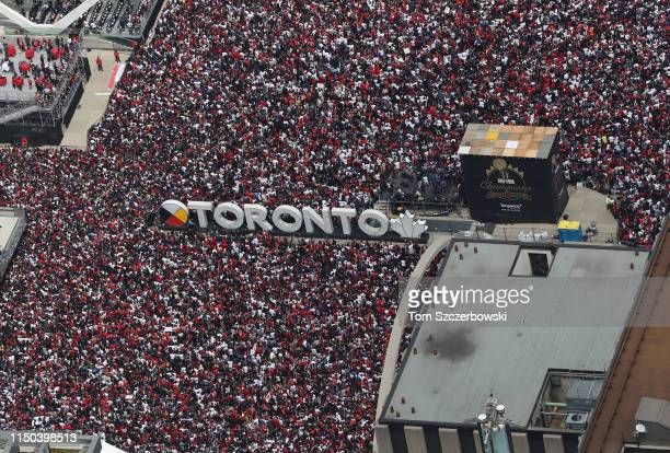 Fans gather at Nathan Phillips Square as they turn out for the Toronto Raptors NBA Championship Victory Parade after defeating the Golden State...