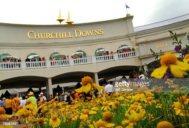 Fans gather at the entrance to the 133rd running of the Kentucky Derby at Churchill Downs on May 5, 2007 in Louisville, Kentucky.