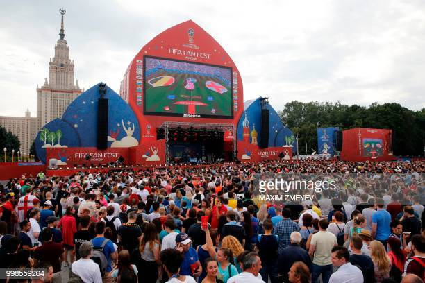 Fans gather at the fan zone in Moscow to watch a live broadcast of the Russia 2018 World Cup third place playoff football match between Belgium and...