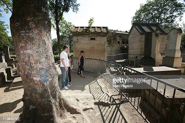 Fans gather at US rock singer Jim Morrison's grave in the 'Pere Lachaise' cemetery on May 8 2011 in Paris France