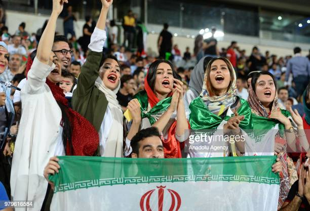 Fans gather for a public viewing event at Azadi Stadium in Tehran Iran on June 20 2018 to watch the 2018 FIFA World Cup Russia Group B match between...