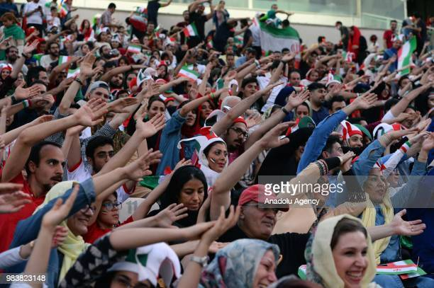 Fans gather for a public viewing event at Azadi Stadium in Tehran Iran on June 25 to watch the 2018 FIFA World Cup Russia Group B match between Iran...