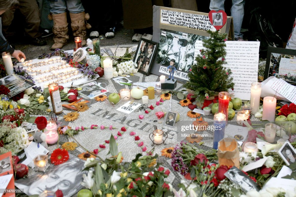 Fans and Mourners Pay Their Respects to John Lennon on the 25th Anniversary of His Death - New York City : News Photo