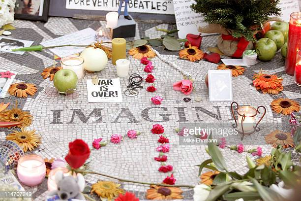 Fans gather for the 25th anniversary of the death of John Lennon at the Strawberry Fields section of Central Park at 72nd Street and Central Park...