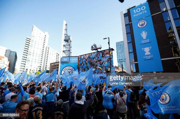 Fans gather for the Manchester City Trophy Parade in Manchester city centre on May 14 2018 in Manchester England