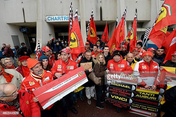 Fans gather in front of the main entrance of Grenoble University Hospital Centre where former German Formula One driver Michael Schumacher is being...