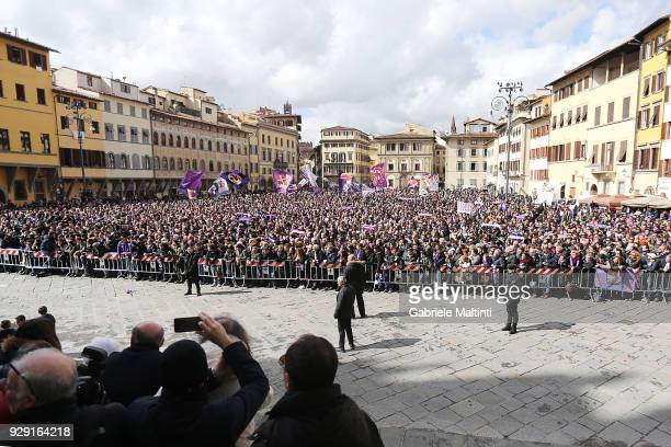 Fans gather in Piazza della Signoria during a funeral service for Davide Astori on March 8 2018 in Florence Italy The Fiorentina captain and Italy...