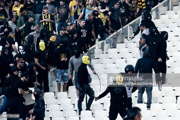 AEK FC fans gather in the stands ahead of the Greek Cup Final football match between AEK FC and PAOK Salonika at the Olympic stadium in Athens on May...