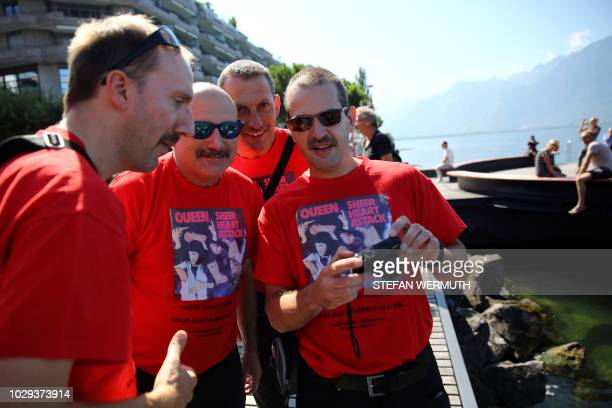 Fans gather near a statue of Queen's late singer Freddie Mercury to celebrate the star's birthday on September 8 2018 in Montreux Queen recorded...