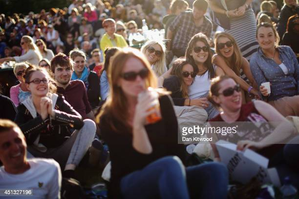 Fans gather on Murray Mound to watch as Andy Murray of Great Britain plays his Gentlemen's Singles third round match against Roberto Bautista Agut of...