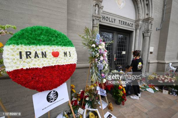 Fans gather outside Michael Jackson's final resting place at the Holly Terrace mausoleum in Forest Lawn Cemetery in Glendale California to remember...