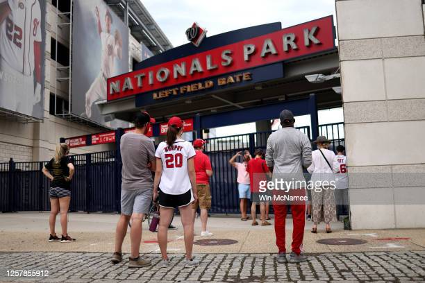 Fans gather outside Nationals Park before the start of the Opening Day game between the Washington Nationals and the New York Yankees July 23, 2020...