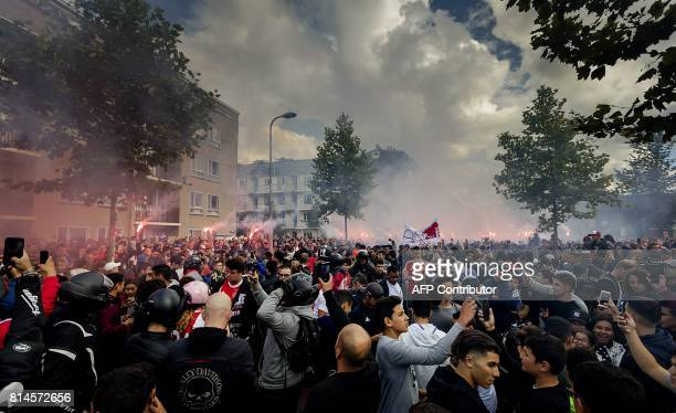 Fans gather outside of the home of Dutch midfielder Abdelhak Nouri on July 14 2017 in Amsterdam Ajax Amsterdam's football player Abdelhak Nouri was...