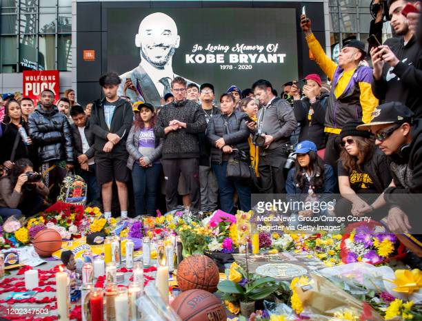 Fans gather outside Staples Center in Los Angeles upon hearing news of his death