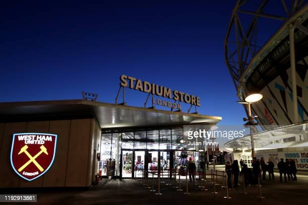 Fans gather outside the club shop prior to the Premier League match between West Ham United and Arsenal FC at London Stadium on December 09 2019 in...