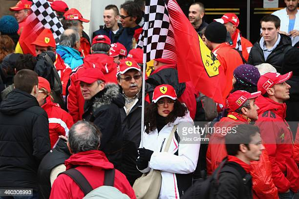 Fans gather outside the Grenoble University Hospital Centre to mark the 45th birthday of former German Formula One driver Michael Schumacher who is...