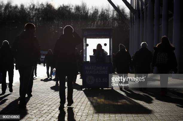 Fans gather outside the ground prior to the Premier League match between Leicester City and Huddersfield Town at The King Power Stadium on January 1...