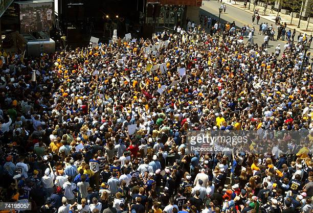 Fans gather outside the HSBC Center to watch the Buffalo Sabres take on the Ottawa Senators in Game 5 of the 2007 Eastern Conference Finals on May 19...