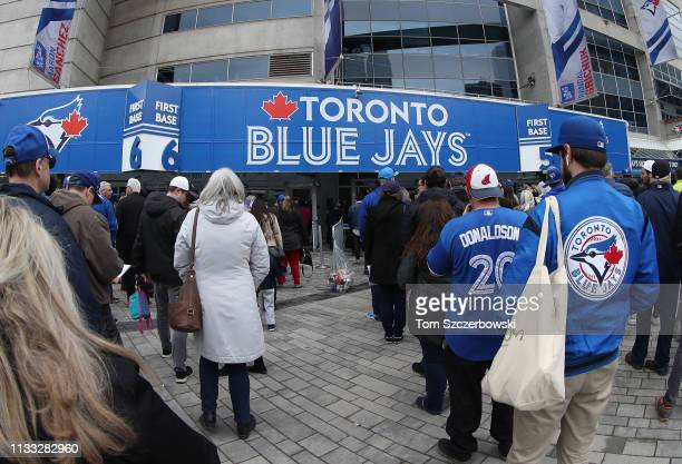 Fans gather outside the Rogers Centre on Opening Day before the Toronto Blue Jays MLB game against the Detroit Tigers at Rogers Centre on March 28...