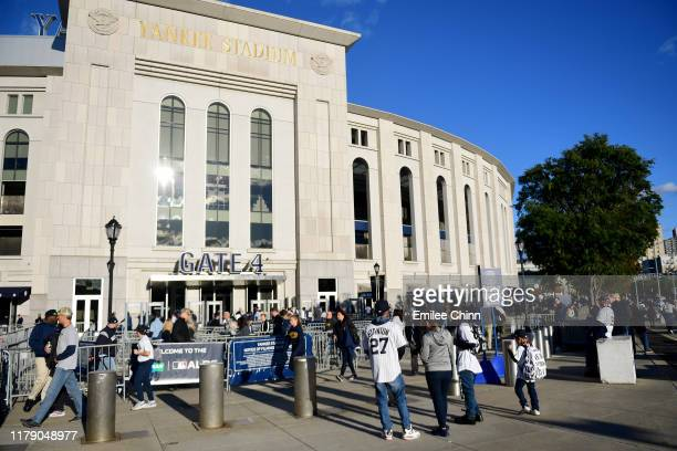 Fans gather outside the stadium prior to game one of the American League Division Series between the Minnesota Twins and the New York Yankees at...