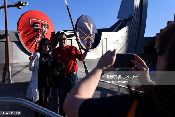 Fans gather outside the stadium prior to the 2019 NCAA men's Final Four National Championship game between the Virginia Cavaliers and the Texas Tech...