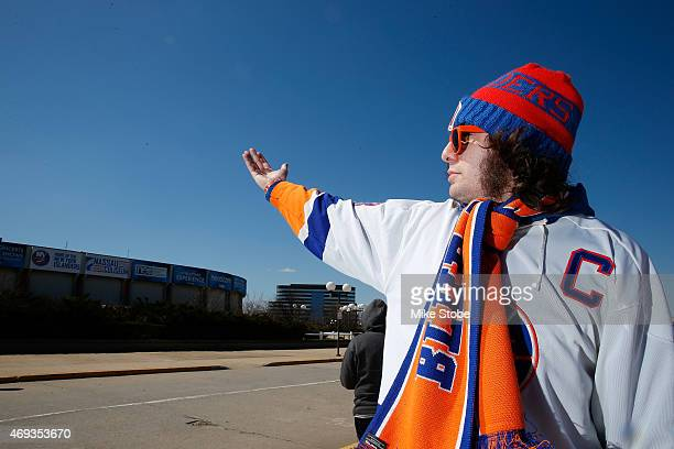 Fans gather prior to the game between the New York Islanders and the Columbus Blue Jackets at Nassau Veterans Memorial Coliseum on April 11, 2015 in...