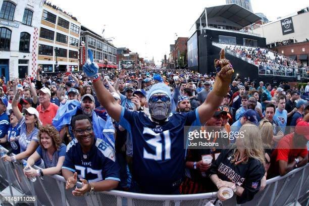 Fans gather prior to the start of the first round of the NFL Draft on April 25 2019 in Nashville Tennessee