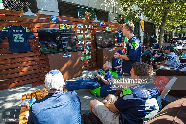 NFL fans gather to celebrate the season at McDonald's season opener kickoff tailgate party on September 4 2014 in Seattle Washington