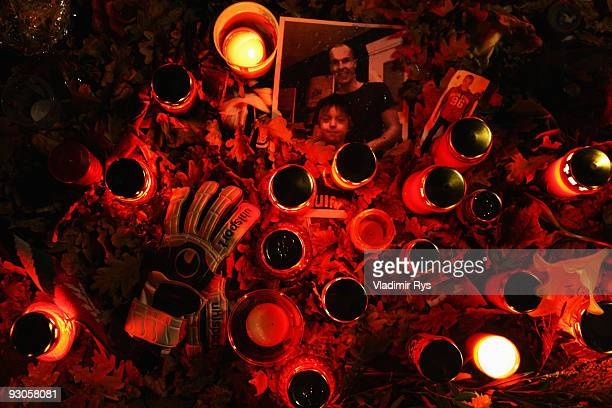 Fans gather to lay down candles and messages in memory of goalkeeper Robert Enke outside of the AWD Arena on November 14 2009 in Hanover Germany Enke...